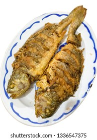Chinese traditional food - grilled whole fishes on plate,isolated on white background