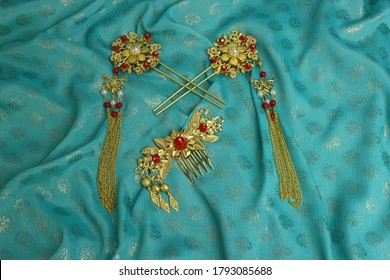 Chinese traditional hairpins hair clips Traditional Chinese women's jewelry. Gold hairpins with red gems. Blue background