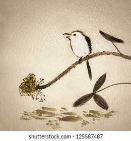 Chinese traditional ink painting with birds and flowers on yellow old canvas.