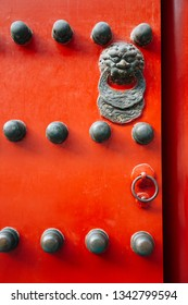 Chinese traditional red door at Forbidden City in Beijing, China