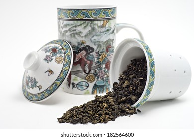 Chinese traditional tea cup with dry tea leaf
