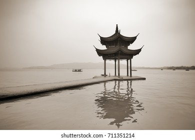 Chinese traditional wooden gazebo on the coast of West Lake, public park in Hangzhou city, China