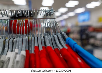 chinese t-shirts on hangers in the shop
