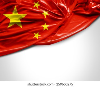 Chinese waving flag on white background