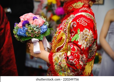 Chinese Wedding, Traditional Dress of Bride with Wedding Bouquet