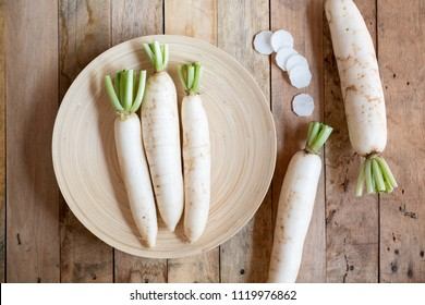 Chinese white radish on wooden background, top view
