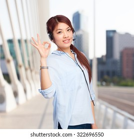chinese woman allright sign with telephone