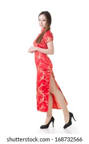 Chinese woman dress traditional cheongsam at New Year, studio shot isolated on white background.