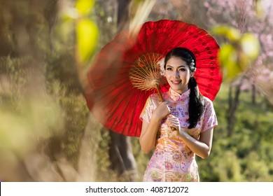 Chinese woman dress traditional cheongsam.