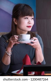 Chinese woman holding a cup