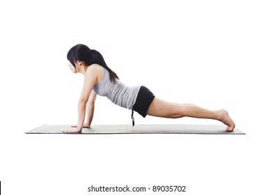 Chinese woman on a yoga mat doing the plank pose.