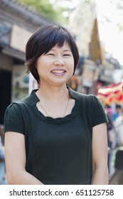 Chinese woman smiling outdoors