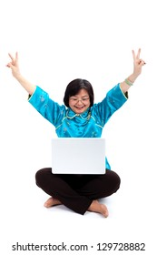 Chinese Woman using a laptop, making the Victory sign, on white background
