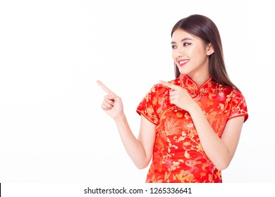 Chinese woman wear qipao for chinese new year day with attractive smile, isolated on white background