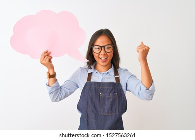 Chinese woman wearing glasses apron holding speech bubble over isolated white background annoyed and frustrated shouting with anger, crazy and yelling with raised hand, anger concept