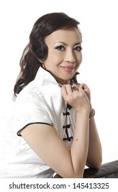 chinese woman in white traditional cheongsam over white background