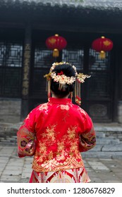 Chinese women traditional dress. The back view in the background of ancient buildings.