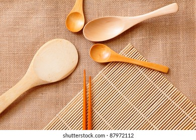 chinese wood tableware on linen tablecloth texture