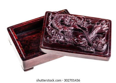 a chinese wooden box with a dragon carved on the lid isolated over a white background