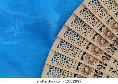Chinese wooden fan on blue pattern