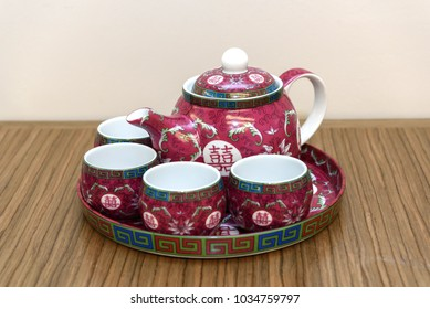 Chinese words mean Double Happiness. Teapot and tea-cup used for the Tea Ceremony during a traditional Chinese wedding in Asia.