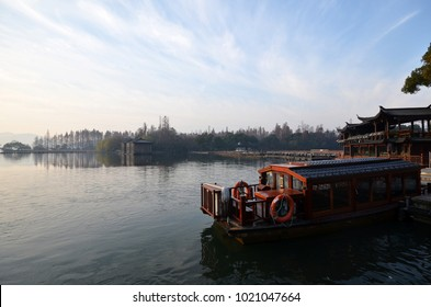 Chinese Xihu lake in Hangzhou with color boat in the morning