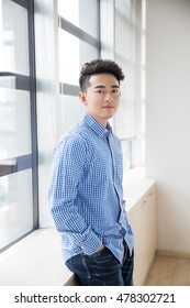 chinese young and handsome young man, wearing a blue shirt