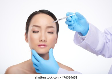 Chinese young woman receiving professional biorevitalization treatment