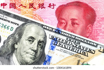 Chinese yuan banknote and american dollar for trade war and economic tax barrier concept