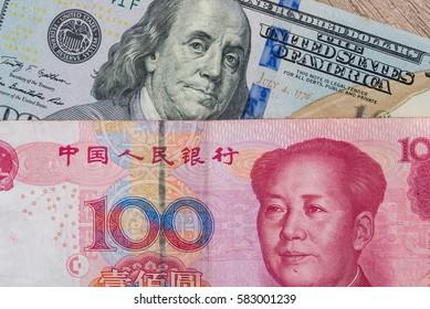 Chinese Yuan bills  vs  U.S. dollar as background .