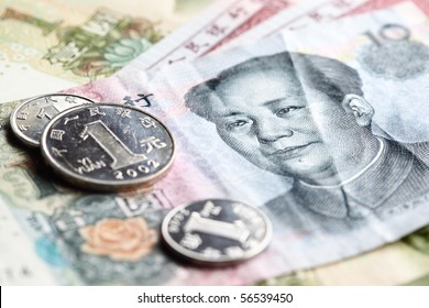 Chinese yuan renminbi banknotes and coins close-up