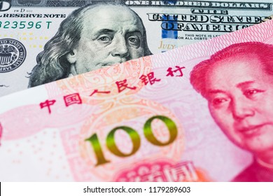 Chinese Yuan and USD dollar bank note, currency exchange rate