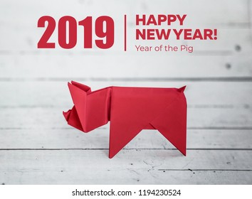Chinese Zodiac Sign Year of Pig, Red paper cut pig, Happy New Year 2019 year. White wood background