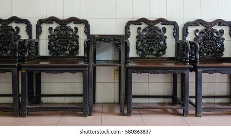 Chinese-style wooden chairs at living room in a temple in Saigon, Vietnam.