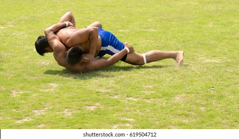 CHINIOT HOCKEY GROUND,PUNJAB,PAKISTAN  5th APRIL 2017. PAKISTANI and INDIAN STYLE WRESTLING ALSO KNOWN AS KABADI OR KUSHTI.IT IS A TRADITIONAL SPORT OF PAKISTAN AND INDIA