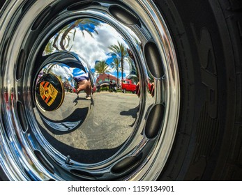 Chino Hills, CA / USA - March 21, 2016: Closeup of a Chrome hubcap of a 1958 Porsche 356A Speedster and its reflections of the surroundings