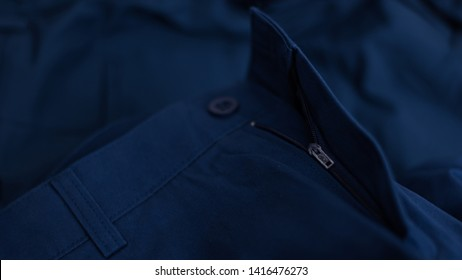 Chino pants navy color fabric cloth material texture textile macro pattern blur background