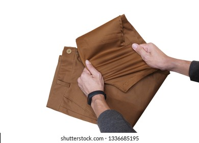 Chino pants spandex brown color stretch by men hand.