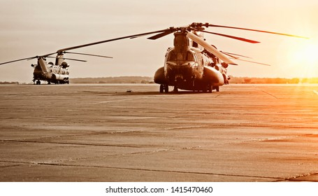 Chinook helicopter on a military airbase with sunset