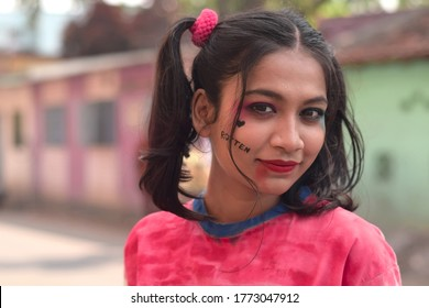 Chinsurah, India - Feb 16, 2020: Close up of a smiling girl in costume Harley Quinn. Happy face, Portrait, Cosplay.