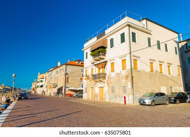 Chioggia - September 2016, Veneto, Italy: Street view in wide angle perspective, old residential houses on the street of Chioggia - coastal town and comune of the City of Venice