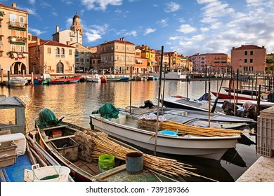Chioggia, Venice, Italy: landscape of the old town and the canal with fishing boats in the ancient city