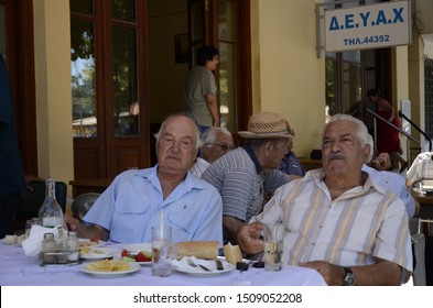 Chios island, Greece - July 18, 2015; Two old man are eating someting in the tavern of Chios Island in Greece.