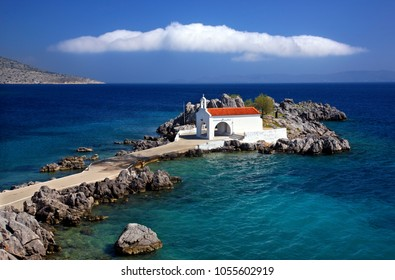 CHIOS ISLAND, NORTH AEGEAN, GREECE. The little church of Agios Isidoros upon a tiny islet, close to Langada town.