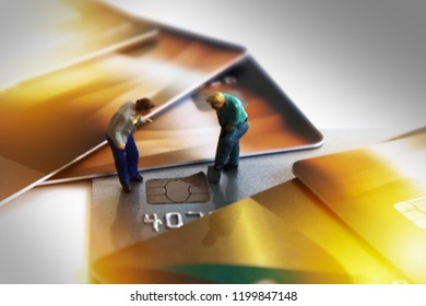 Chip of Credit Card removed from card by miniature mini figures digger. Card Theft Concept. Hacker steal Credit Cards  information card Usecurity  For Unauthorized Shopping. Unauthorized Payment