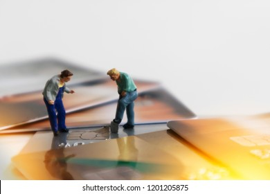 Chip of Credit Card removed from card by miniature mini figures digger. Card Theft Concept. Hacker steal Credit Cards  information on card Usecurity  For Unauthorized Shopping. Unauthorized Payment