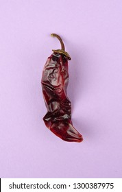 Chipotle Chili (dried jalapeño, Capsicum annuum, Morita Variety), isolated on a violet background