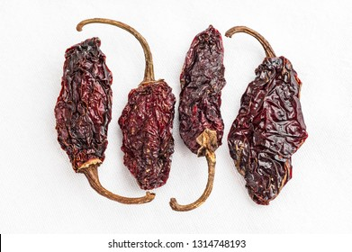 Chipotle Morita chili peppers on a white background
