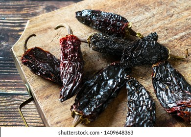 Chipotle, smoke-dried ripe chile pepper used for seasoning primarily in Mexican and Mexican-inspired cuisines.