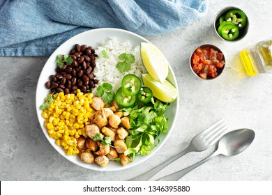 Chipotle spicy chicken lunch bowl with rice corn, beans, rice and jalapenos